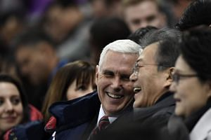 US Vice-President Mike Pence (centre) talks to South Korea's President Moon Jae-in during the short track speed-skating event.
