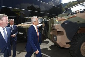 Australian Prime Minister Malcolm Turnbull inspecting the Bushmaster armoured vehicle during a visit to Thales Underwater Systems in New South Wales late last month. Mr Turnbull wants Australia to move into the top 10 in arms exports, up from its cur