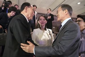 South Korean President Moon Jae In (right) talks with the sister of North Korean leader Kim Jong Un, Kim Yo Jong (centre), and Kim Yong Nam, president of North Korea's Presidium of the Supreme People's Assembly, after attending a concert.