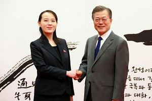 Ms Kim Yo Jong, the sister of North Korean leader Kim Jong Un, shaking hands with South Korea President Moon Jae In at the Blue House in Seoul of Feb 10, 2018.
