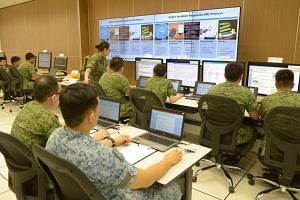 Soldiers at a demonstration to show how they would handle cyber threats at the Cyber Defence Test and Evaluation Centre on Dec 12, 2017.