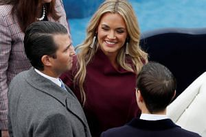 Donald Trump Jr. and his wife Vanessa speak with Jared Kushner during inauguration ceremonies for the swearing in of Donald Trump as the 45th president of the United States on the West front of the US Capitol in Washington on Jan 20, 2017.