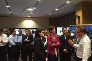 Second Minister for Home Affairs and Manpower Josephine Teo (fourth from right) at the launch of Security Industry Transformation Map (ITM) at the Lifelong Learning Institute, on Feb 13, 2018.