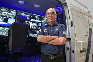 Senior security supervisor Eric Holmberg and two colleagues work from a roving command centre in a van that receives feeds from hundreds of closed-circuit TV cameras, allowing them to monitor large areas.