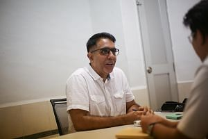 Mr Pritam Singh at a Meet-the-People Session in Jalan Damai on Monday. Mr Singh and WP chief Low Thia Khiang are both known for their effectiveness in communicating, their down-to-earth manner - and the ability to be direct and blunt when it matters.