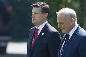 Porter (left) walking with White House Chief of Staff John Kelly in August 2017.