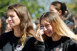 Students mourn during a community prayer vigil for the victims of the shooting.