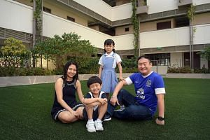 Mr Edwin Chan with his wife, Ms Cecilia Chiang, 40, and their children, Jade, eight, and Jackie, six, at the Cannosian Eduplex. Mr Chan is glad that his son will be able to join his daughter, who is in Primary 2, at Canossa Convent Primary when it st