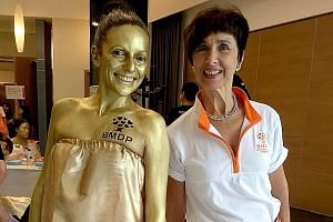 Ms Jane Prior with a Bone Marrow Donor Programme volunteer wearing body paint to turn herself into a human statue during a campaign on World Marrow Donor Day in 2016. Ms Prior announced in a Facebook post on Jan 29 that she is stepping down as chief