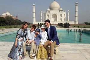 Canadian PM Justin Trudeau and his family posing for a picture in front of the Taj Mahal on Feb 18, 2018.