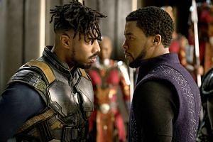 Michael B. Jordan (left) plays Erik Killmonger and Chadwick Boseman as T'Challa in Black Panther.