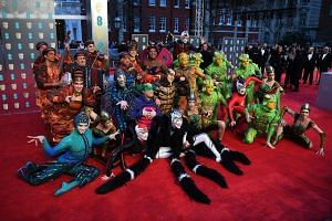 Members of the Cirque de Soleil arrive ahead of the 71st annual British Academy Film Awards at the Royal Albert Hall in London, on Feb 18, 2018.