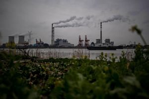 A file photo of the Huangpu river and the Wujing Coal-Electricity Power Station in Shanghai.