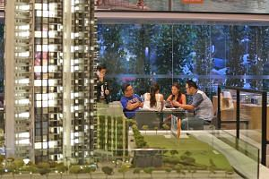 Potential buyers with housing agents at the Gem Residences showroom in Toa Payoh yesterday. The stamp duty change was announced at about 5.20pm, when most showflats were closing, catching many by surprise.