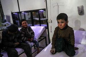 Injured children receiving medical treatment inside a hospital in rebel-held Douma, Eastern Ghouta, Syria, on Feb 19, 2018.