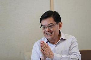 As for when exactly the GST hike will take effect, Finance Minister Heng Swee Keat said it depends on the economy and financial markets.