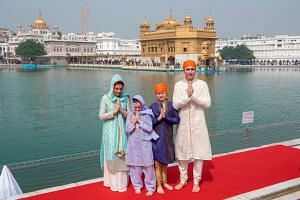 Canadian Prime Minister Justin Trudeau with his wife Sophie Gregoire Trudeau, daughter Ella-Grace and son Xavier at the Sikh Golden Temple in Amritsar on Feb 21, 2018.