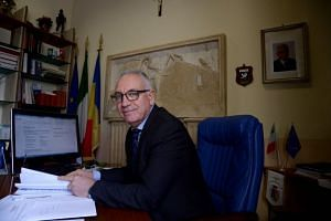 The mayor of Guidonia Montecelio Michel Barbet, elected with the anti-establishment Five Star Movement, sits in his office in Guidonia on Feb 1, 2018.