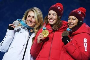 (From left) Silver medal winner Mikaela Shiffrin of the USA, gold medal winner Michelle Gisin of Switzerland and bronze medal winner Wendy Holdener of Switzerland during the medal ceremony for the women's alpine combined race at the 2018 Winter Games