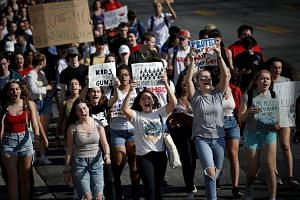 Students from Montgomery Blair High School march down Colesville Road in support of gun reform legislation on Feb 21, 2018, in Silver Spring, Maryland.