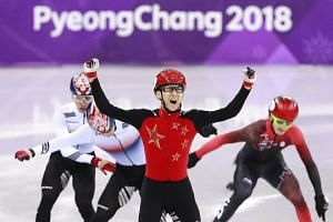 Wu Dajing is ecstatic after winning the thrilling 500m short-track speed skating final in a world record at the Gangneung Ice Arena last night. It was China's first gold of these Winter Olympics.