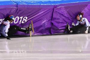 South Korea's Shim Suk Hee (left) and Choi Min Jeong crash during the women's 1,000m short track speed skating A final during the Pyeongchang 2018 Winter Olympic Games, at the Gangneung Ice Arena on Feb 22, 2018.