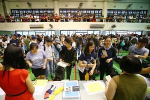 Students from Hwa Chong Institution collect gift bags before receiving their A-level results on Feb 23, 2018.