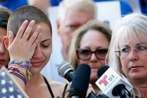 Marjory Stoneman Douglas High School student Emma Gonzalez reacts during her speech at a rally for gun control at the Broward County Federal Courthouse in Fort Lauderdale, Florida, on Feb 17, 2018.