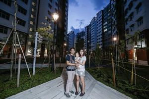 Mr Adrian Tay and his wife Joan Tan, with their year-old daughter Kiersten, at their new place in Admiralty Grove.