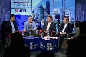 At the Budget roundtable were (from left) UOB economist Francis Tan, Koda sales and marketing executive director Ernie Koh, MP and NTUC director Melvin Yong, Singapore Business Federation chairman Teo Siong Seng and moderator Lee Su Shyan, Business e