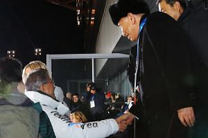 South Korean President Moon Jae In (left) greeting North Korean delegation leader Kim Yong Chol at the closing ceremony of the Pyeongchang Olympic Games, on Feb 25, 2018.