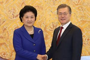 South Korean President Moon Jae In (right) meets with Chinese Vice Premier Liu Yandong at the presidential Blue House in Seoul, on Feb 26, 2018.