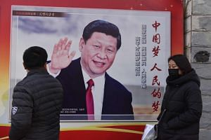 A poster of Chinese President Xi Jinping in Beijing on Feb 26, 2018.