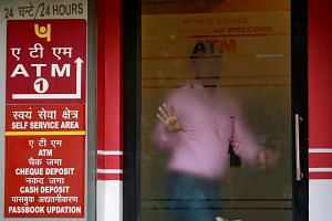 A man leaves an automated teller machine facility of Punjab National Bank in New Delhi on Feb 27, 2018.