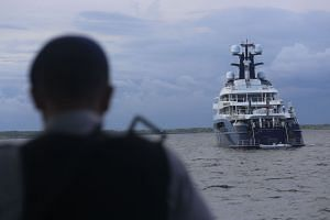 Indonesian officials prepare to board the luxury yacht Equanimity at Benoa Bay in Bali, on Feb 28, 2018.