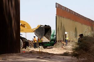 US Customs and Border Protection engaging in construction work on the US-Mexico border near Calexico, California, on Feb 22, 2018.