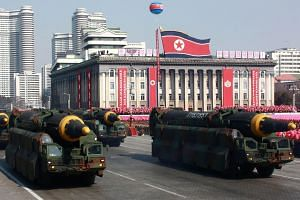 Hwasong-12 ballistic missiles are part of a military parade to mark the 70th anniversary of the Korean People's Army.