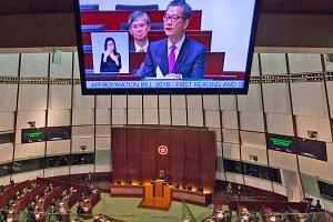 Financial Secretary Paul Chan presenting the Hong Kong Budget for 2018 at the city's Legisaltive Council yesterday.