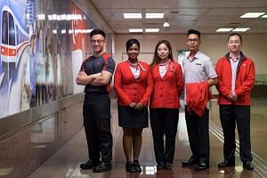 SMRT staff with their new uniforms. (From left to right) Assistant engineer Tan Ze Yang, 24, assistant station manager, Gowri D/O Veren, 38, assistant station manager, Zhai Xinyu, 24, train captain Mohamad Rezza Bin Abdul Malek, Male, 31 and train se