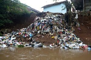 Waste from houses dumped into the Citarum river in Majalaya, West Java.