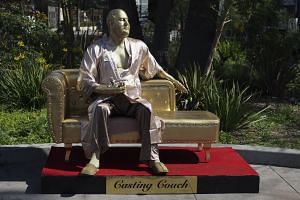 An art installation, meant to represent disgraced film producer Harvey Weinstein, sits on Hollywood Boulevard ahead of the Academy Awards in Los Angeles on March 1, 2018.