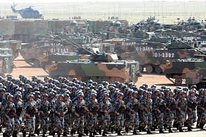 A military parade marking the 90th anniversary of the founding of the People's Liberation Army last July. Some defence experts say China is eroding the US' military technology dominance and that the PLA could surpass the US military in AI capabilitie