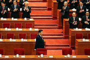 President Xi Jinping at a National People's Congress session in Beijing last March. The CCP central committee has proposed abolishing the term limits in the Constitution, which will pave the way for Mr Xi to stay on as president for life, but observe