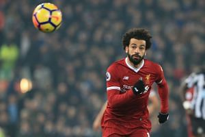 Salah chases the ball during the match against Newcastle.