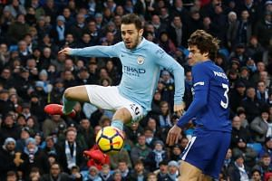 Manchester City's Bernardo Silva scores their first goal at Etihad Stadium, Manchester, Britain on March 4, 2018.