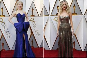 Nicole Kidman and Jennifer Lawrence pose on the red carpet at the 90th Annual Academy Awards held at the Dolby Theatre in Hollywood, California on March 4, 2018.