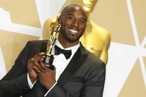 Kobe Bryant poses with his award for best animated short during the 90th annual Academy Awards ceremony on March 4, 2018.