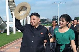North Korean leader Kim Jong Un and his wife Ri Sol Ju at an event on Rungna Islet along the Taedong River in Pyongyang in a 2012 photo. Ms Ri is rarely seen at diplomatic events.