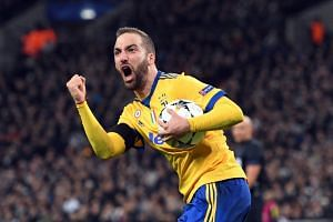 Juventus' Gonzalo Higuain celebrates scoring.