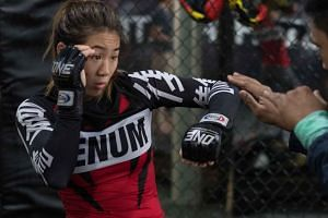 One Women's Atomweight World Championship winner Angela Lee practising at Evolve Mixed Martial Arts.